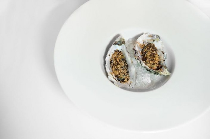 Smoked oysters, crusty bread seaweed Nori and lime cream Chef Andrea Madonia